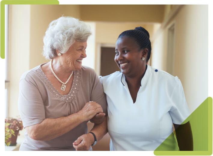 Caretakers taking care of elderly woman